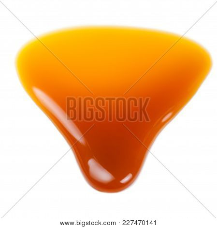 Sweet Caramel Sauce Isolated On White Background. Golden Butterscotch Toffee