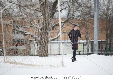 Image of running athlete near gate in stadium