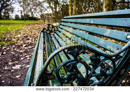 Empty Bench In Park Relax But Lonely. Calm Sunny Day In Park.