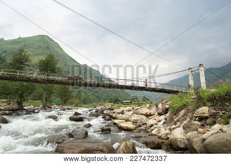 Yen Bai, Vietnam - Sep 18, 2016: A Week And Small Bridge Crossing River In Area Of Ethnic Minorities