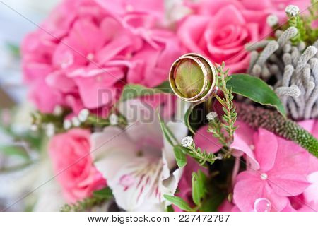 Wedding Rings In The Bouquet Of Pink Flowers