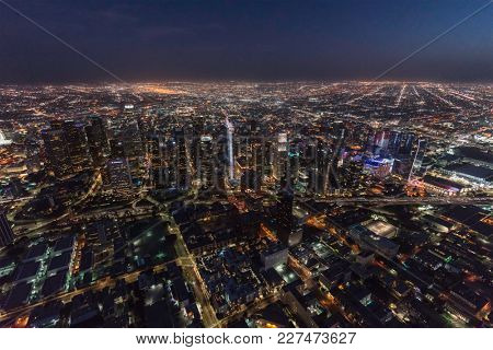 Los Angeles, California, USA - February 11, 2018:  Night aerial view of downtown skyline towers and streets in Southern California.