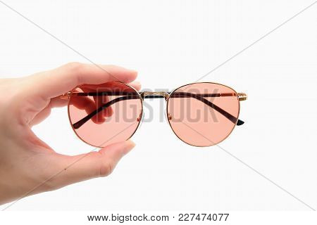 Pink Lens Sunglasses Isolated. Holding Sunglasses On White Background.