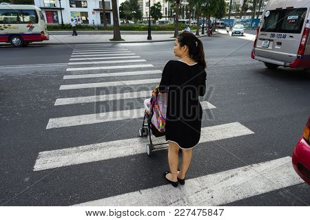 Hanoi, Vietnam - Oct 19, 2016: Mother With A Baby Stroller Crossing The Street In Minh Khai. Vehicle
