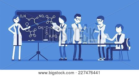 Students In The Lab. Young People Studying At A University, Have Chemistry Lesson In Physical Or Nat