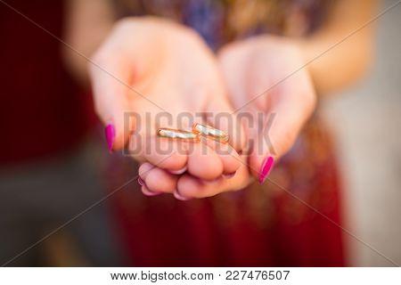 Golden Wedding Rings In Hands Of Woman. Wedding Detail. Love