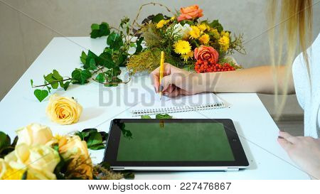 Shooting Close-up Of Tablet And Hands Of  Female Flower Designer