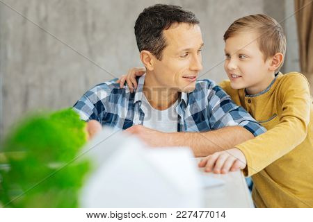 Precious Bond. Charming Pre-teen Boy Hugging His Father And Chatting With Him While Bonding To Him D