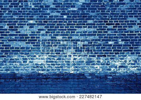 Weathered Brick Wall Background In Navy Blue Tone. Abstract Background And Pattern.