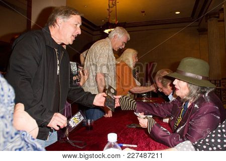 Martha Davis talks with fans at the Wild Honey Orchestra and Friends tribute to Buffalo Springfield meet-and-greet at the Alex Theatre in Glendale, CA on Feb. 17, 2018.
