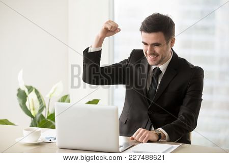Happy Smiling Businessman Celebrating Victory In Business, Excited With Good Results In Work, Feelin