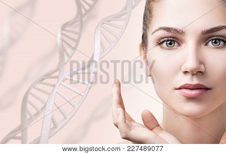 Portrait Of Sensual Woman Among White Dna Chains Over Beige Background