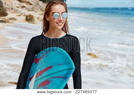 Extreme Sport, Adventure And Active Lifestyle Concept. Skilled Female Surfer Has Outdoor Activities,