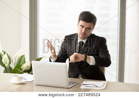 Stressed Businessman Looking At Wrist Watch And Worrying Because Of Lack Of Time, Late On Business M