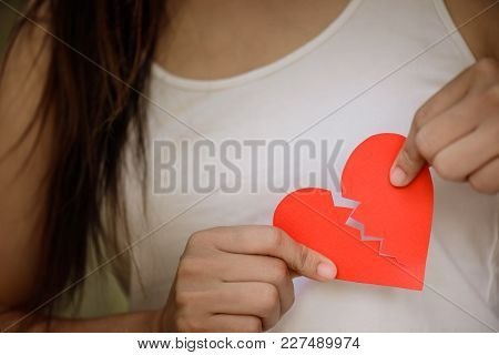 Young Woman Showing Red Ripped Paper Heart. Broken Hearted On Valentines Day Concept.