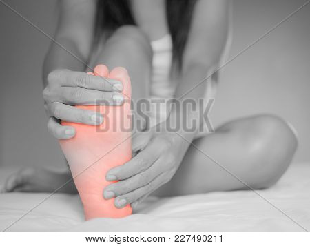 Black And White Female Foot Pain, Health Care Concept.