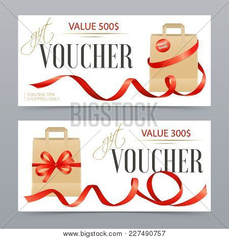 Two Different Value Realistic Vouchers Decorated With Red Satin Ribbons On Luxury Gift Bags Isolated