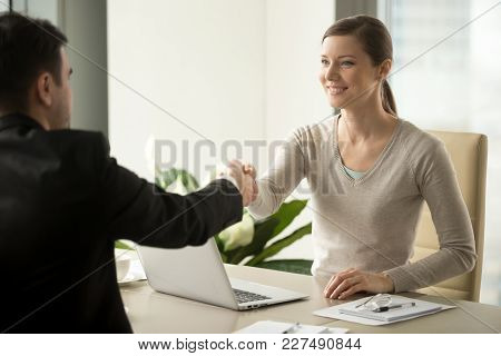 Smiling Female Company Leader Welcoming With Handshake Male Business Partner Before Or After Busines