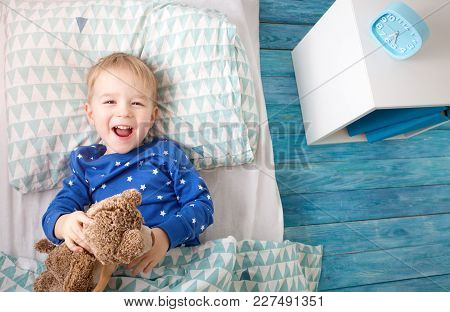 Three Years Old Child Lying In Bed. Boy On Pillow In Bedroom