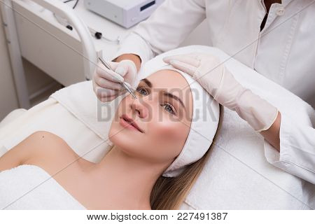 Look After Your Youth! Blackhead Cleansing On Woman Face During Facial Treatment At Beauty Clinic. Y