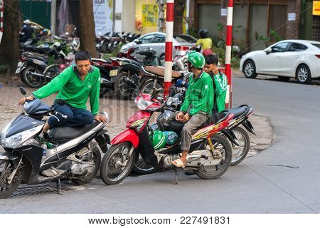 Hanoi, Vietnam - July 7, 2017: Gab Motorbike Driverswaiting For Customer On Ba Trieu Street. Entered