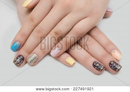 Women's Hands With A Colored Nail Polish Manicure . Isolate On White