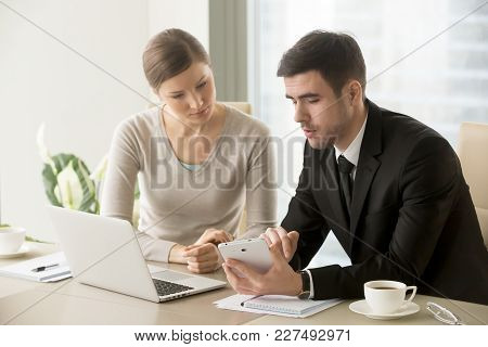 Millennial Businessman Showing Project Calculations, Concept Design, Drawings, Financial Indicators