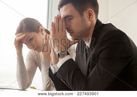 Stressed Male And Female Business Persons Sitting At Desk, Hard Thinking About Problem. Businessman