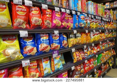 Shanghai, China- Jan 22, 2018: Various Brand Of Potato Chips And Snacks In Packaging For Sale On Sup