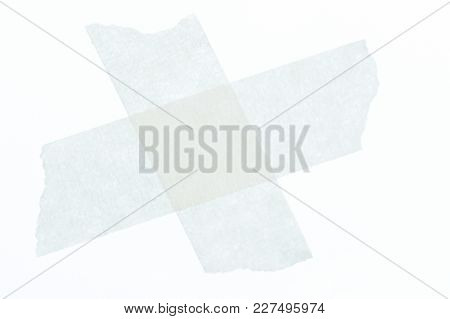 Cross From Masking Tape Isolated On White Background