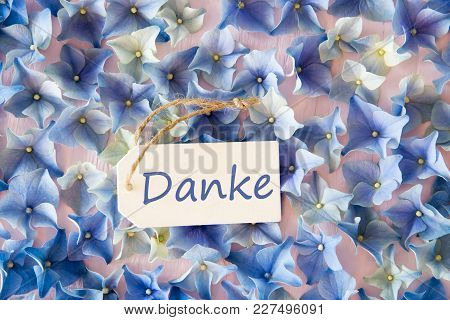 Label With German Text Danke Means Thank You. Flat Lay Of Hydrangea Blossoms.