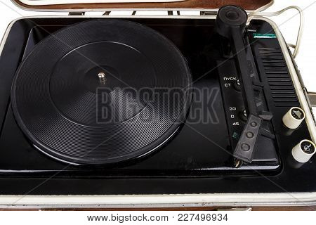 Closeup Of Open Vintage Suitcase Turntable Isolated On White Background