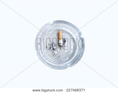 Top View Of Glass Ashtray With Single Cigarette Butt Und White Table Surface
