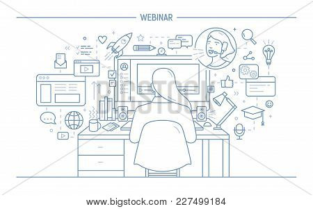 Woman Sitting At Computer Surrounded By Web Symbols And Watching Webinar Or Online Lecture, Back Vie
