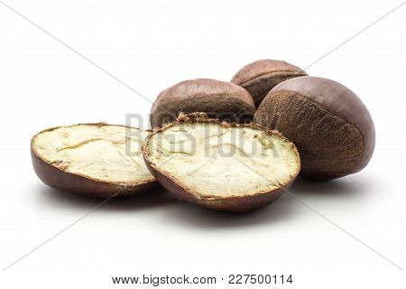 Three European Chestnuts And Two Halves Spanish Edible Isolated On White Background Raw Fresh Brown