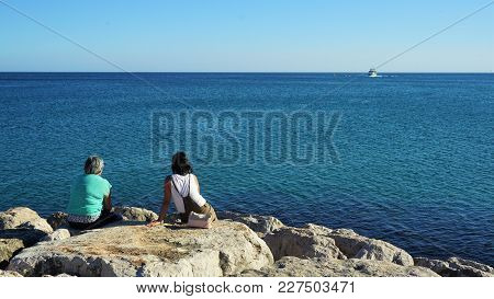 In Anticipation Of The Spouses Of Fishermen.atlantic Coast In Sesimbra , Portugal.