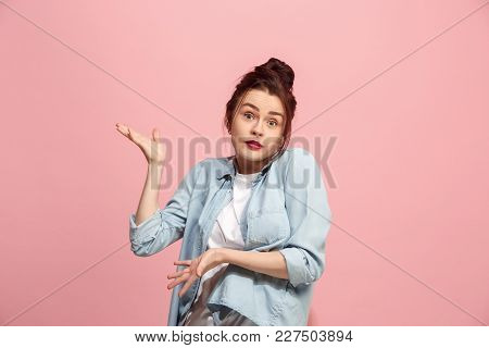 Why Is That. Beautiful Female Half-length Front Portrait Isolated On Pink Studio Backgroud. Young Em