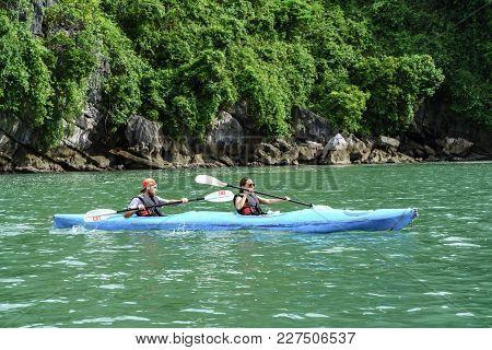 Quang Ninh, Vietnam - Aug 12, 2017: Tourists Paddling Kayak On Halong Bay In Vietnam, Unesco World H