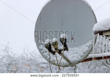 Snow-covered Antenna For Receiving Satellite Tv In Winter