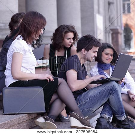 Group Of Fellow Students With Books And Laptop.education Concept