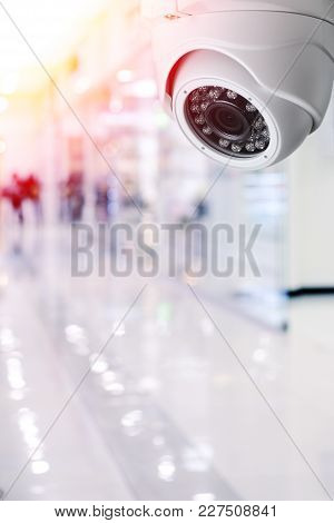 Cctv Camera Security System On A Ceiling Of A Shopping Mall Blurred Background.