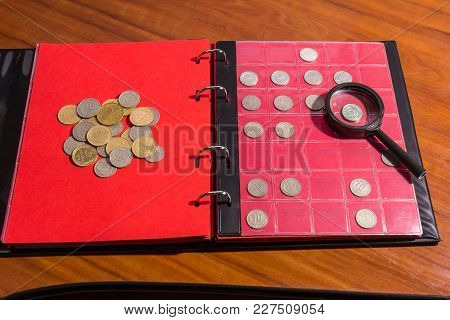 Page Of Numismatics Album With Different Coins Isolated.