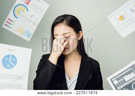 Business Woman In A Black Suit Is Throw Away A Lot Of Paperwork And The Documents Are Blown Overhead