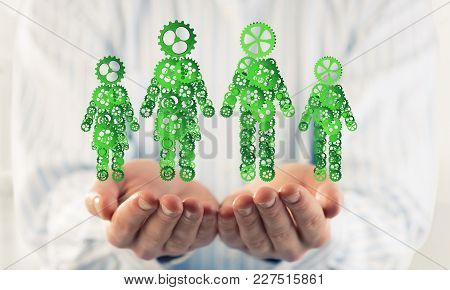 Close Of Male Hands Holding With Care Figures Of Family