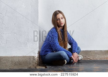 Girl Near Wall. Stylish Girl Hipster Teen. Fashion Pretty Teenager Caucasian Sits Floor. Style Young