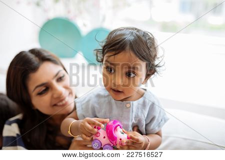 Little Indian Girl Playing With Her Mother