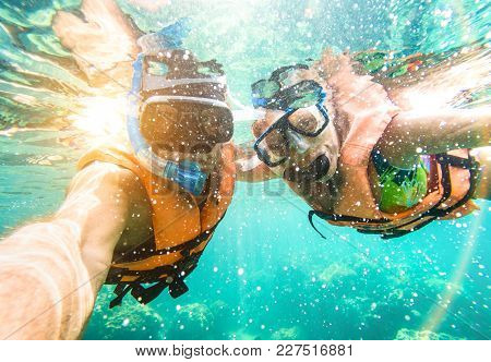 Senior Happy Couple Taking Selfie In Tropical Sea Excursion With Water Camera - Boat Trip Snorkeling