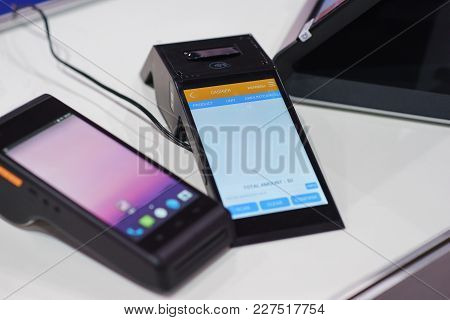 Modern Wireless Terminal For Payment With A Touch Screen. Customer Service In A Sales Outlet Using M