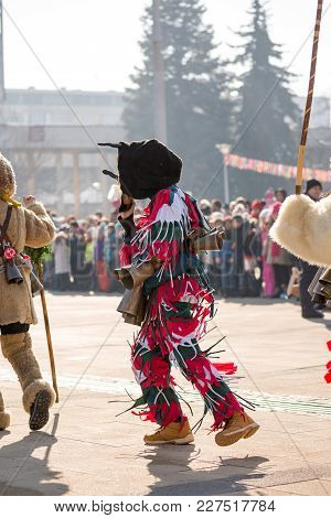 Pernik, Bulgaria - January 26, 2018: Masked People - Kukeri March, Perform And Dance To Banish Away