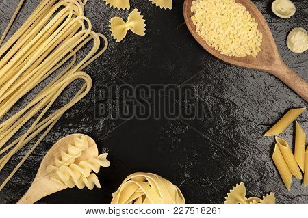 An Overhead Photo Of Different Types Of Pasta, Including Spaghetti, Orzo, Fusilli, Penne, Shot From